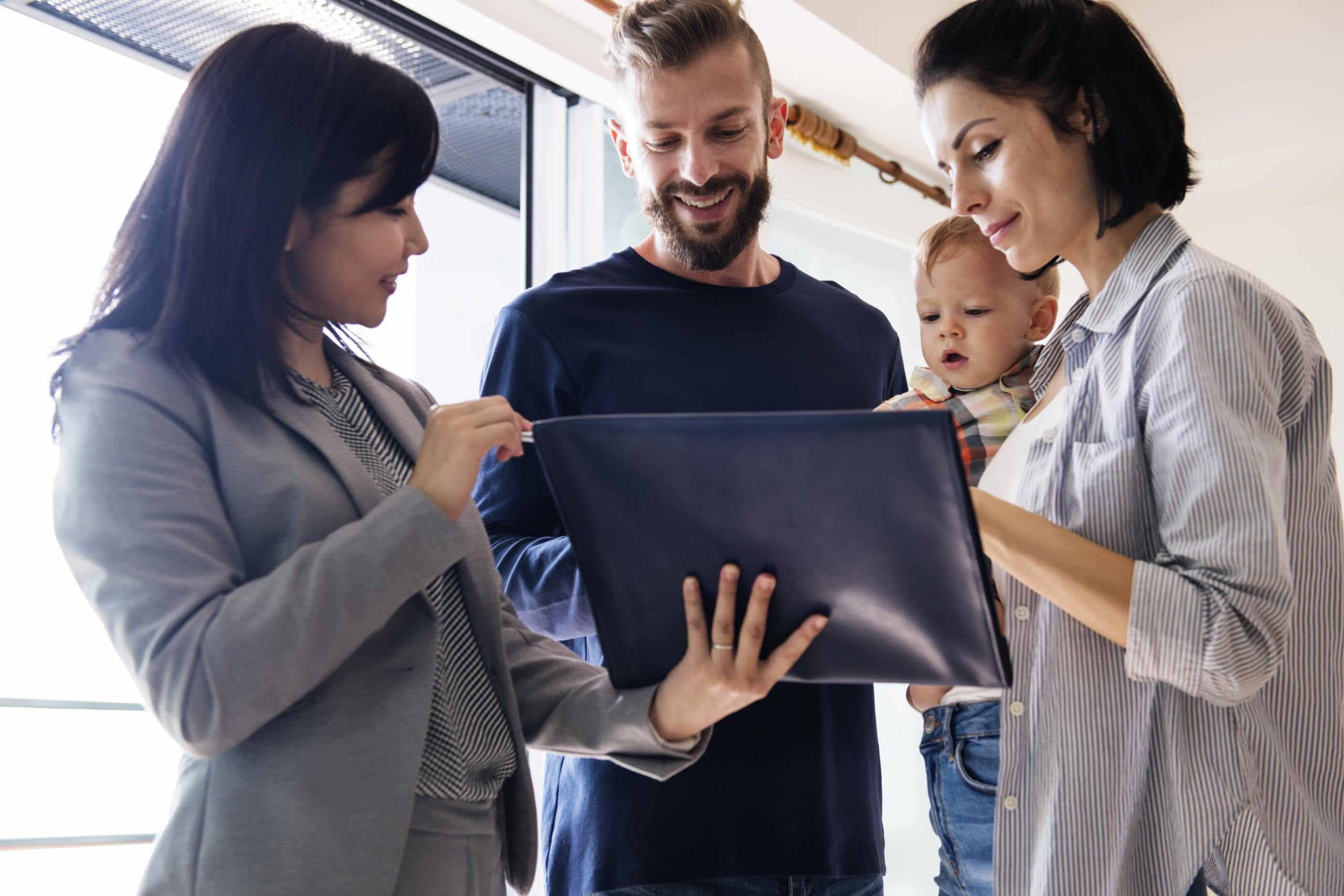 family learns about buying a new house while selling their own